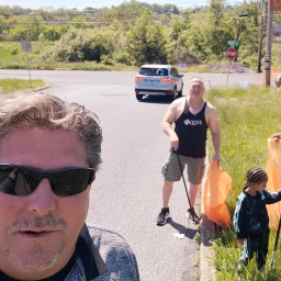 Commissioner Connolly and some volunteers picking up trash along Sue Drive